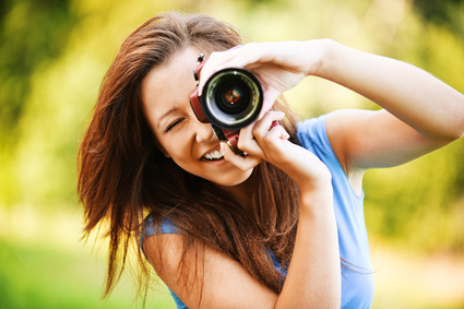 young smiling girl making photo